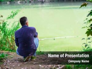 River man sitting bank fishing,