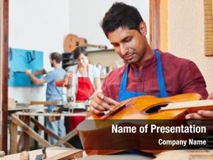 Maker trainee guitar repairs guitar