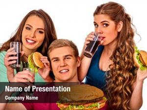 Holiday party eating hamburger fast food