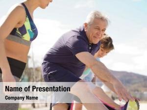Stretching senior people beach help