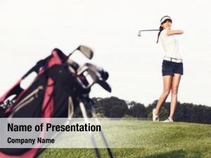 Player girl golf hitting ball