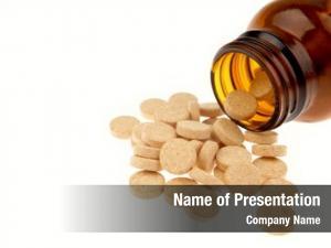 Spilling vitamin tablets bottle