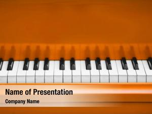 Orange piano keys piano close