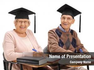 Cheerful seniors with graduation