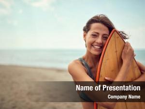 Girl smiling surfer posing her