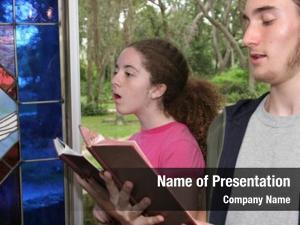 Girl teen boy singing hymns