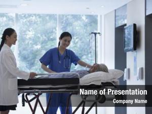 Nurse female doctor wheeling stretcher