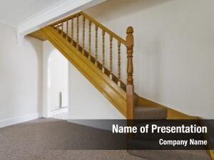 Wooden staircase carpet rails