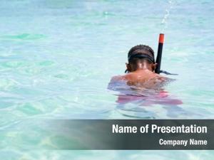 Snorkeling little boy crystal clear