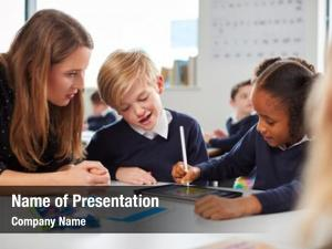 Teacher female school helping two