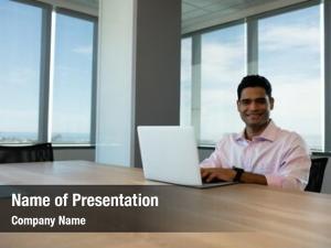 Conference room portrait of smiling businessman