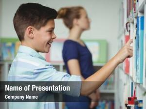Schoolboy selecting powerpoint theme