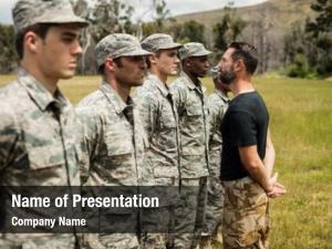 American troops training trainer giving