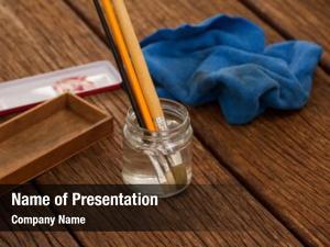 Dissolving paint brush in a jar
