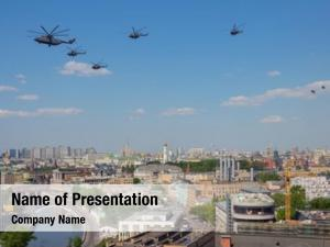 During helicopters fly military parade