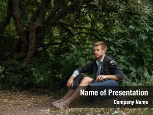 Ground businessman sitting desert island