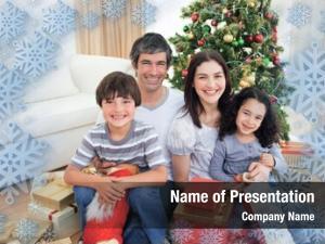 Portrait family christmas against snowflake