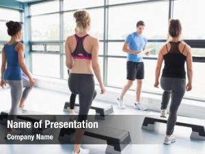 His trainer teaching aerobic class