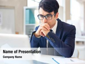 Reading businessman concentrating online data