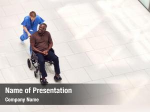 Nurse overhead view wheeling male
