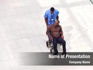 Male overhead view nurse wheeling