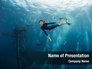 Swims lady diver underwater sunken