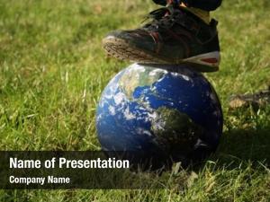 Globe conceptual stepping green grass