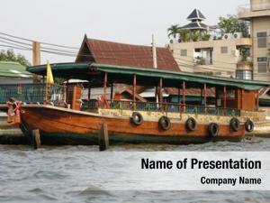 Moored ferry boat riverside