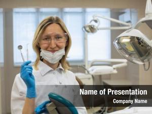 Dentist portrait female tools over