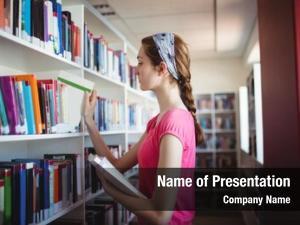 Book schoolgirl selecting book shelf