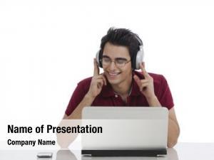 Music man listening headphones laptop