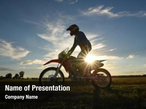 Country motocross rider side sunset