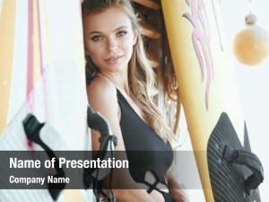 Posing surfer woman surfboard