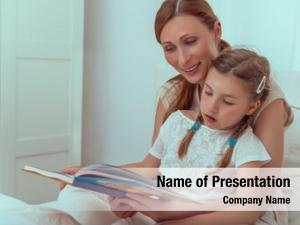 Girl educating little reading books