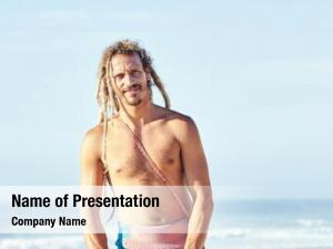 Adult portrait young shirtless surfer
