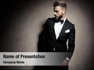 Man elegant fashion tuxedo holding