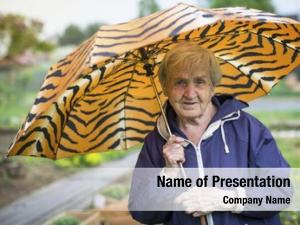 Umbrella old woman outdoors