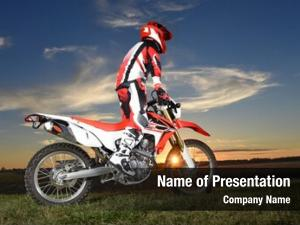 Standing motocross rider motocycle during