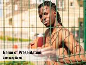 Basketballer young african holding ball