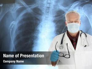 Doctor handsome medical surgeon stands