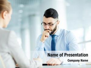 Pensive businessman sitting opposite his