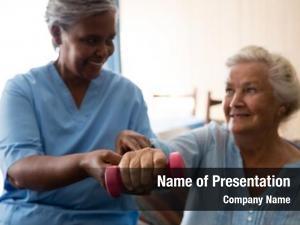 Retirement community nurse helping senior