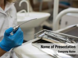 Hands female dentist holding detail