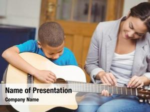 Giving pretty teacher guitar lessons