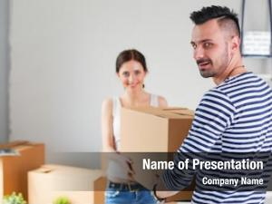 Couple happy young unpacking packing