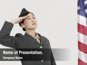 Military serious female officer saluting