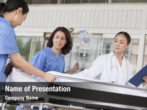 Doctor female paramedics wheeling patient