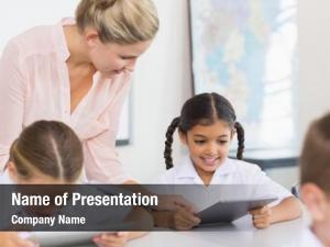 School teacher teaching girl digital