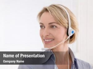 Headphone blond assistant looking sideways
