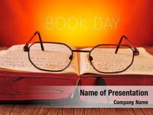 Open pair eyeglasses old book